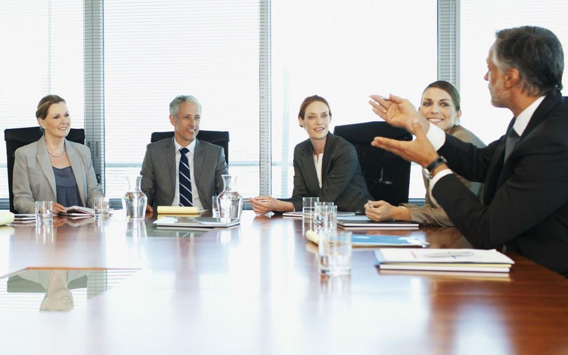 Board having discussion around board room table